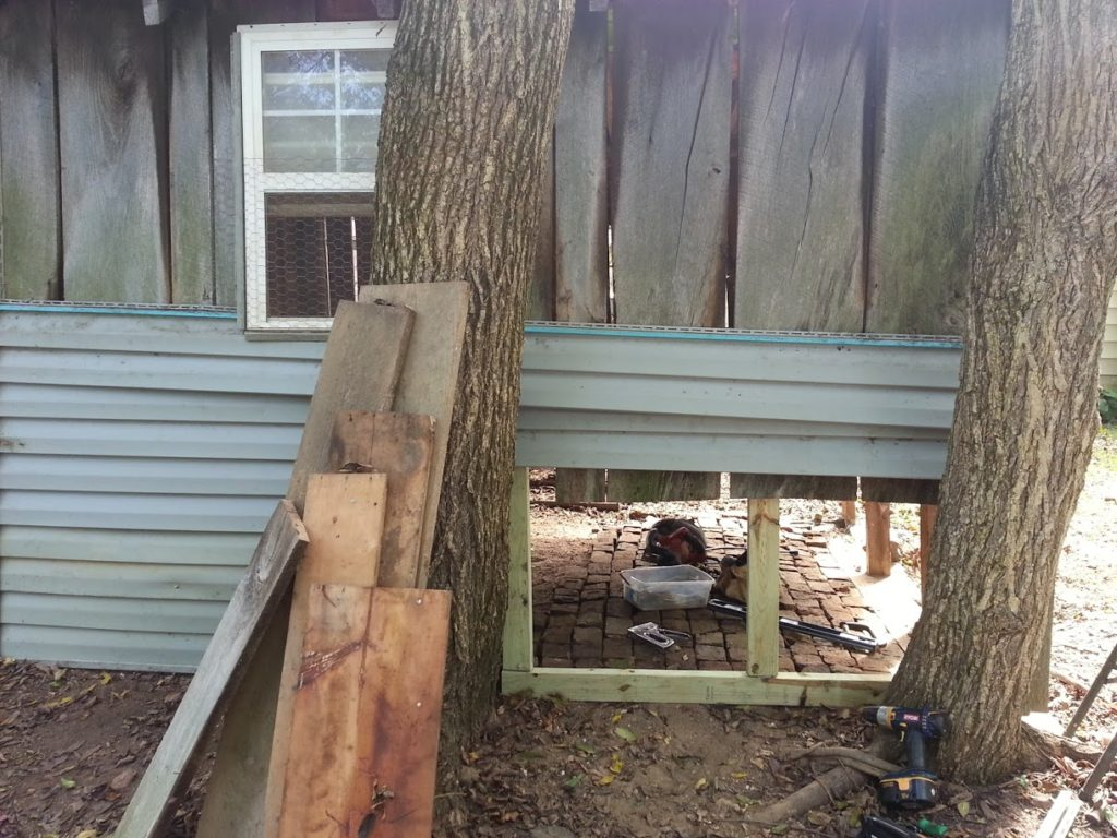 One side had two trees growing out of it so we used some leftover siding from our previous house to build a wall around the trees. My brain is still recovering from this one.